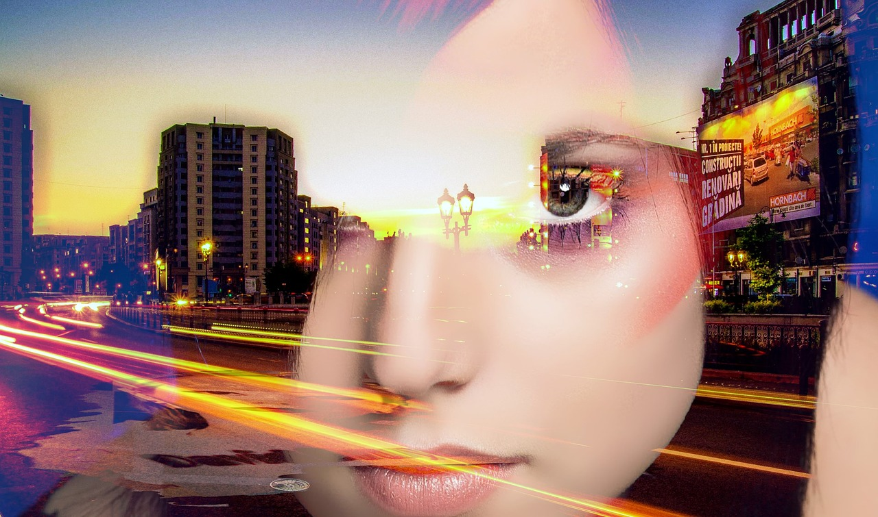 cityscape with womans face superimposed