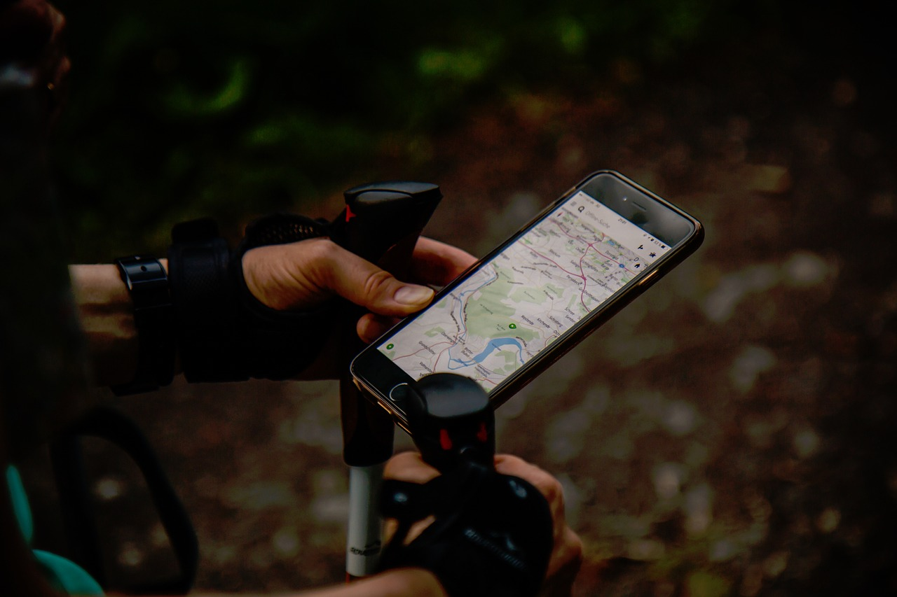 hiker holding a phone with gps